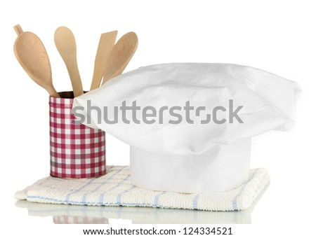Chef's hat with kitchen towel and spoon isolated on white