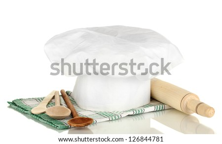 Chef's hat with spoons and battledore isolated on white - stock photo