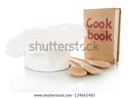 Chef's hat with spoons and cook book isolated on white - stock photo