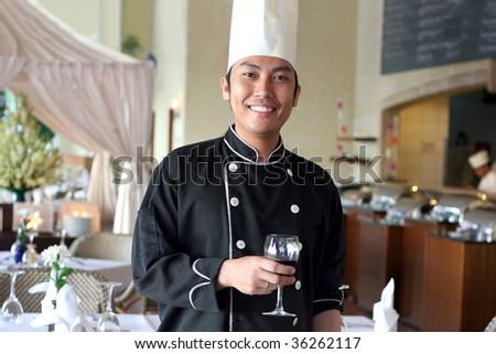 chef salute at restaurant - stock photo