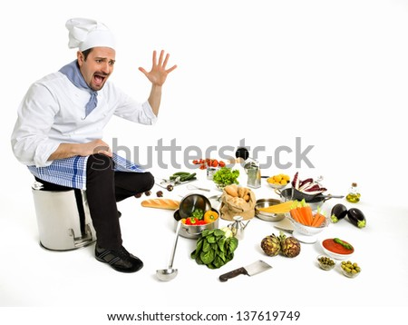 Chef scared seeing all the ingredients to create a new recipe - stock photo