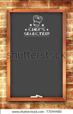 chef selected chalkboard on brick wall