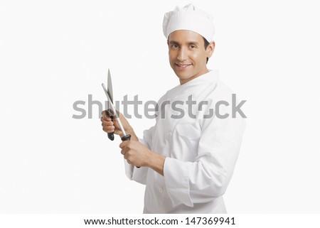 Chef sharpening knife - stock photo