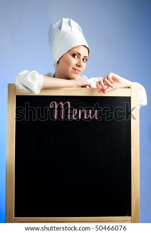 Chef show lunch menu on blackboard - stock photo