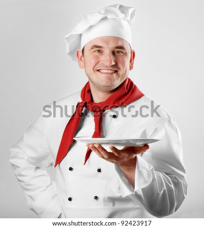 Chef showing empty plate - stock photo
