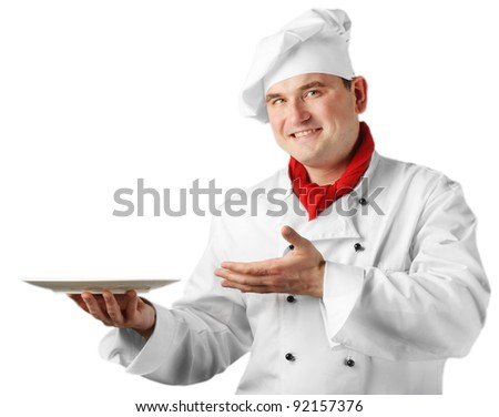Chef showing empty plate isolated on white