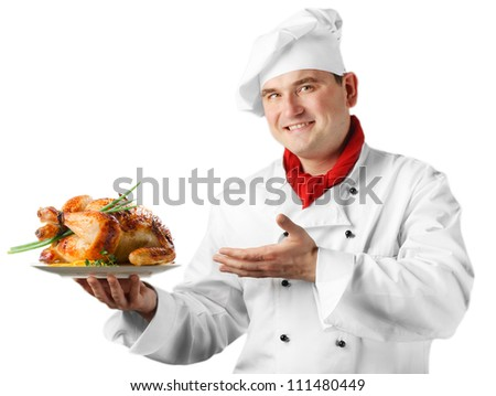 Chef showing  plate with roasted chicken isolated on white