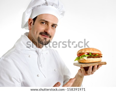 chef shows his delicious ham burger - stock photo