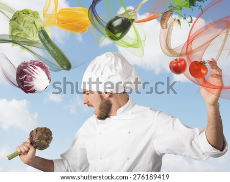 Chef sings with an artichoke as microphone - stock photo