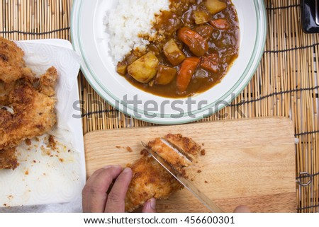 Chef slicing Tongkatsu for decorated Japanese pork curry / cooking Japanese pork curry paste concept - stock photo