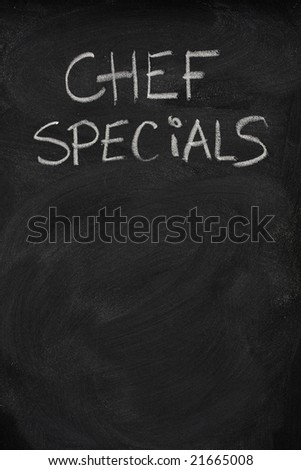 chef specials title handwritten with white chalk on blackboard, copy space below - stock photo