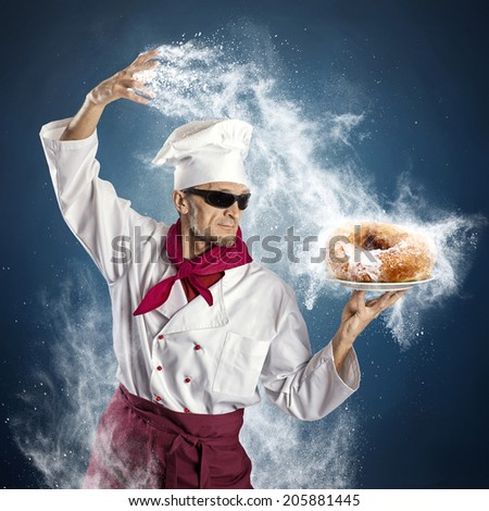 Chef sprinkle powdered sugar donut - stock photo