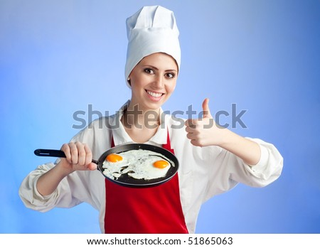 Chef stand with frying egg and pan with big smile and thumb up - stock photo