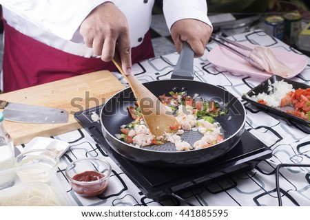 Chef stir chicken in the pan for cooking / cooking spaghetti concept  - stock photo