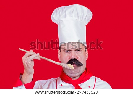 Chef tasting the food from wooden spoons - stock photo