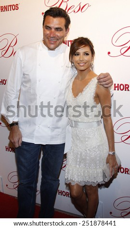 Chef Todd English and actress Eva Longoria Parker arrive to the opening of Beso Restaurant held at the Beso in Hollywood, California, United States on March 6, 2008.  - stock photo