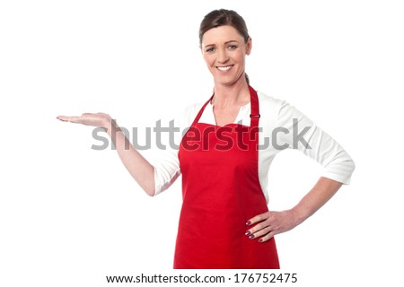 Chef welcoming you to her restaurant - stock photo