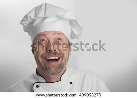 chef with a beard, smiling from ear to ear - stock photo