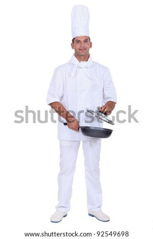 Chef with a frying pan - stock photo