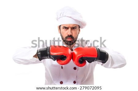 Chef with boxing gloves sitting on the floor