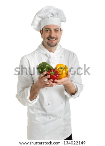 Chef with colorful peppers - stock photo