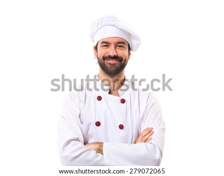 Chef with his arms crossed over white background - stock photo