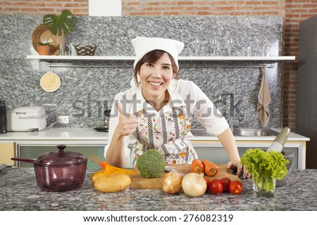 chef with mortar, An Asian woman chef smiling cooking with Thai mortar in the kitchen - stock photo