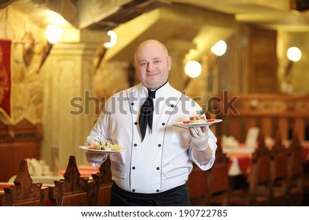chef with prepared food - stock photo