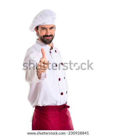 Chef with thumb up over white background - stock photo
