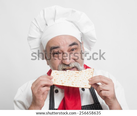 chef with wine and matza bread for passover celebration - stock photo