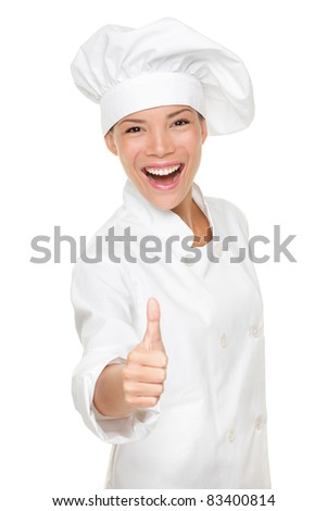 Chef woman - happy thumbs up. Smiling and cheerful female chef, cook or baker in uniform and hat isolated on white background.
