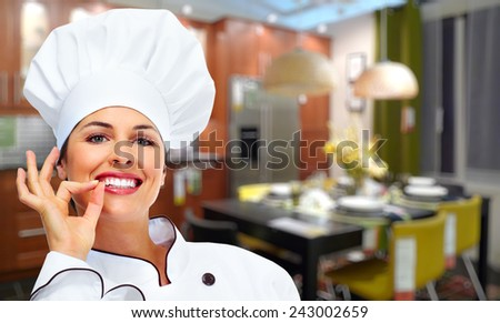 Chef woman portrait in a modern kitchen. Cooking. - stock photo