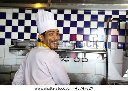 chef working and smiling - stock photo