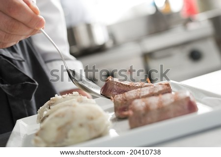 Chef working on professional kitchen