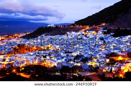 Chefchaouen Medina at twilight, Morocco. Chefchaouen is a city in northwest Morocco. It is the chief town of the province of the same name, and is noted for its buildings in shades of blue. - stock photo
