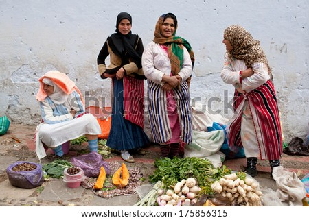 CHEFCHAOUEN, MOROCCO - JANUARY 02: Unidentified smiling women poses for a photo in the souk on January 02, 2014 in Chefchaouen, Morocco.