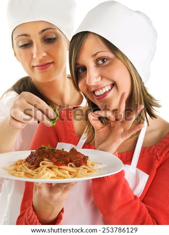 Cheffs with spaghetti bolognese isolated on white, expressing positivity - stock photo