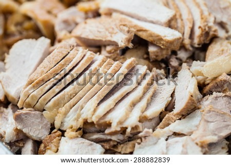 Chefs are shredded pork with knife. - stock photo