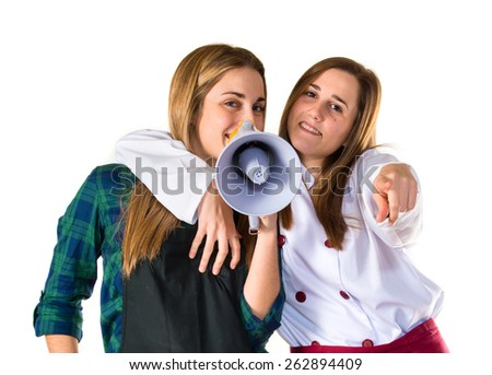 Chefs shouting by megaphone   - stock photo