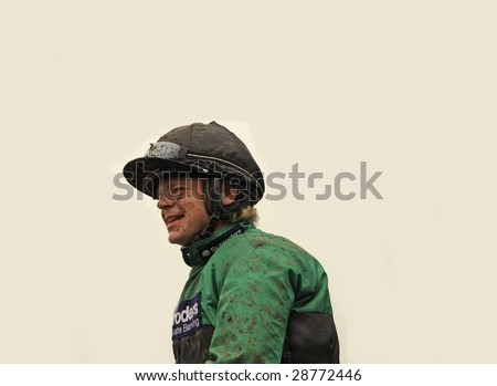 CHELTENHAM, GLOUCS, APRIL 17 2009:  Winning jockey Robert Chocolate Thornton returns muddy from winning on Bensalem in the second race at the April National Hunt meeting at Cheltenham Racecourse, UK - stock photo