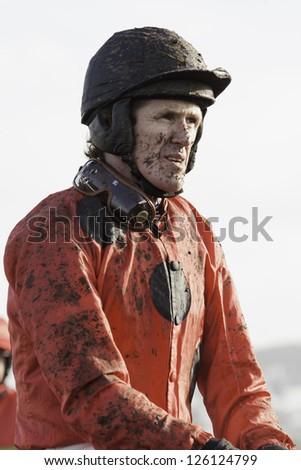 CHELTENHAM, GLOUCS-JANUARY 26: Jockey A P McCoy returns from the second race with John's Spirit at Festival Trials Day, Cheltenham Racecourse, Cheltenham UK on Jan 26, 2013. - stock photo