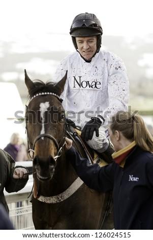 CHELTENHAM, GLOUCS-JANUARY 26: Jockey Barry Geraghty returns as winner with Rolling Star the first race at Festival Trials Day, Cheltenham Racecourse, Cheltenham UK on Jan 26, 2013. - stock photo
