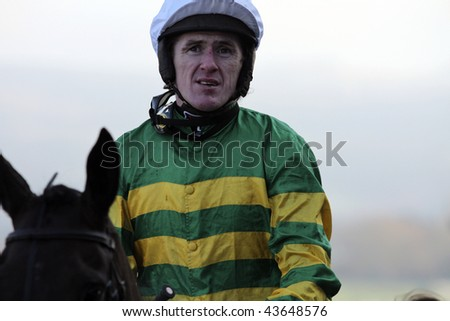 CHELTENHAM, GLOUCS: jockey A P McCoy rides Four Strong Winds to second place over hurdles in the first race at Cheltenham Racecourse, UK, January 1 2010, Cheltenham, Gloucestershire - stock photo