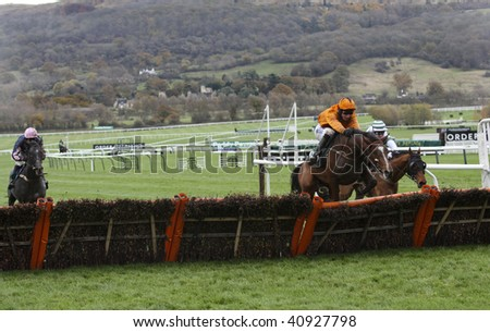CHELTENHAM; GLOUCS; NOV 14: jockey Daryl jacobs takes the fence and goes onto win the first race at Cheltenham Racecourse, UK, November 14 2009, in Cheltenham, Gloucs - stock photo