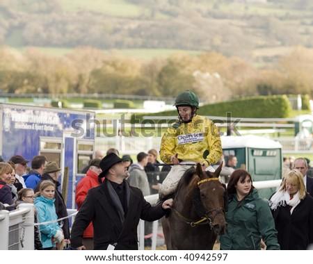 "CHELTENHAM, GLOUCS; NOV 14: jockey jamie moore returns riding ""hold em"" after the fourth race at Cheltenham Racecourse, UK, November 14, 2009 in Cheltenham, Gloucs - stock photo"