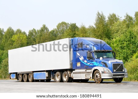 CHELYABINSK REGION, RUSSIA - AUGUST 1, 2010: Blue Volvo VNL64T semi-trailer truck at the interurban road. - stock photo