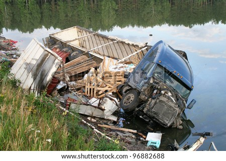 CHELYABINSK REGION, RUSSIA - AUGUST 14: Hard truck crash on a freeway on August 14, 2009 in Satka district, Chelyabinsk region, Russia. - stock photo