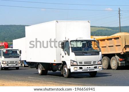 CHELYABINSK REGION, RUSSIA - JULY 19, 2008: White Isuzu NQR cargo truck at the interurban road. - stock photo