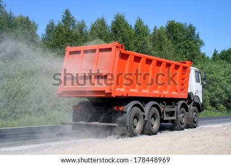 CHELYABINSK REGION, RUSSIA - JUNE 22, 2008: New MZKT Volat dump truck at the interurban road. - stock photo