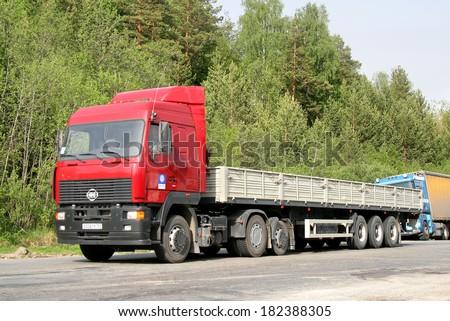 CHELYABINSK REGION, RUSSIA - MAY 24, 2008: Red MAZ 6430 semi-trailer truck at the interurban road. - stock photo